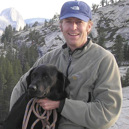 The photo of Kevin that was used in his memorial program with Rally and his makeshift rope leash.