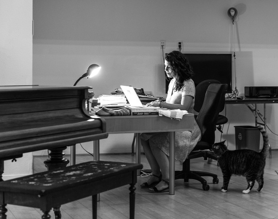 Author Jennifer Zeynab Joukhar, a portrait of her at work by Tina Case.